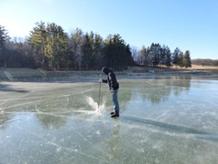 Checking the ice to make sure it is safe.